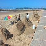 Sand-made sculptures at the beach